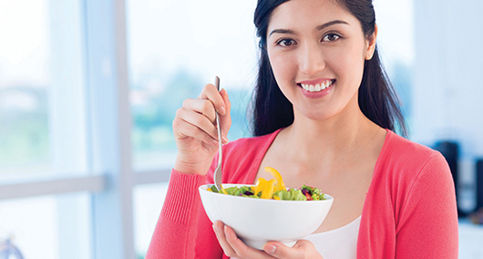 Girl eating salad