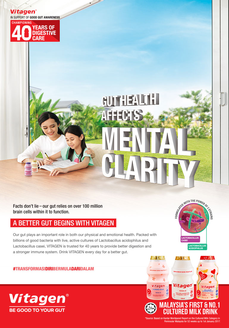 VITAGEN gut health affects mental clarify mother guiding daughter through homework with VITAGEN bottle drink on table